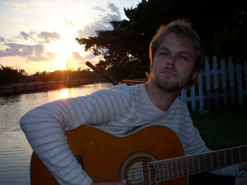 Son David enjoying a little guitar in the moonlight on Ocracoke,nc.